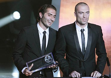 Hamit Altintop (left) of Turkey receives the FIFA Puska Award 2010 from goalkeeper Andrei Sidelnikov of Kazakhstan during the FIFA Ballon D'Or ceremony