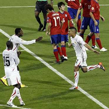 Bahrain's Faouzi Aaish celebrates after scoring his goal against South Korea