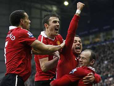 Man United's Javier Hernandez celebrates after scoring