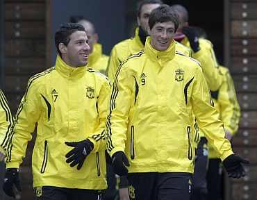 Liverpool's Fernando Torres and Maxi Rodriguez