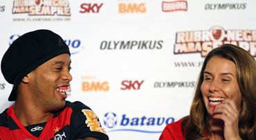 Brazilian soccer club Flamengo's president Patricia Amorim (R) laughs with newly-signed member Ronaldinho Gaucho during a news conference after his presentation in Rio de Janeiro