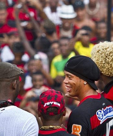 Ronaldinho (R) is all smiles during his presentation