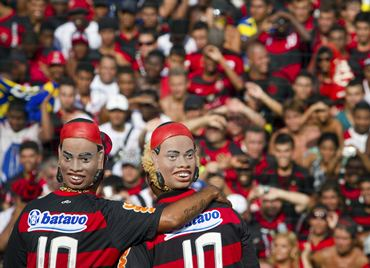 Performers wear masks of Ronaldinho