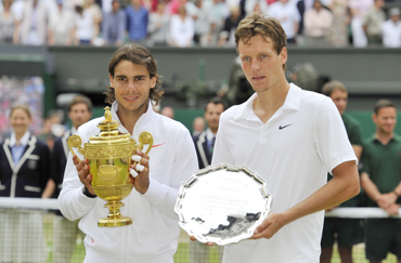 Rafael Nadal and Tomas Berdych with their Wimbledon trophies