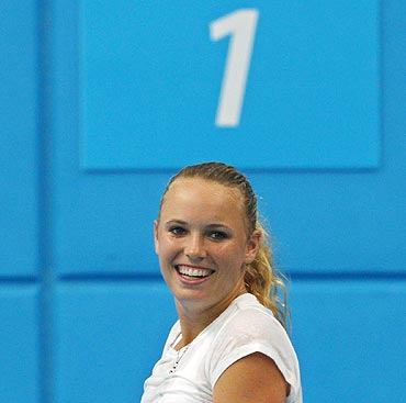 Caroline Wozniacki of Denmark smiles during a training session at Melbourne Park