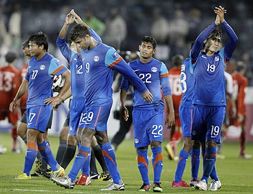 India's players react after losing against Bahrain in the Asian Cup match on Friday