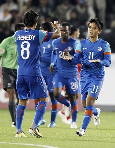 India's Renedy Singh congratulates Sunil Chhetri