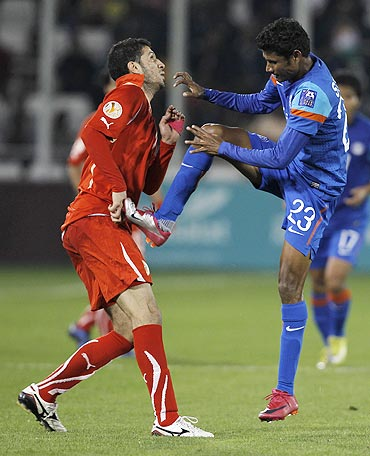 Bahrain's Hamad Rakea (left) collides with India's Steven Dias
