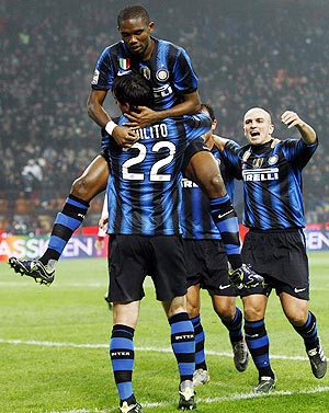 Inter Milan's Samuel Eto'o (top) celebrates with teammates after scoring against Bologna on Saturday