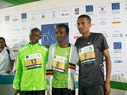 Aseefa (No 8) is flanked by Muriki (No 13) Wolde at the victory ceremony