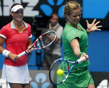 Kim Clijsters of Belgium hits a shot during a Rally for Relief match in Melbourne on Sunday