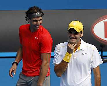 Rafa Nadal and Roger Federer look on during a Rally for Relief tennis match in Melbourne