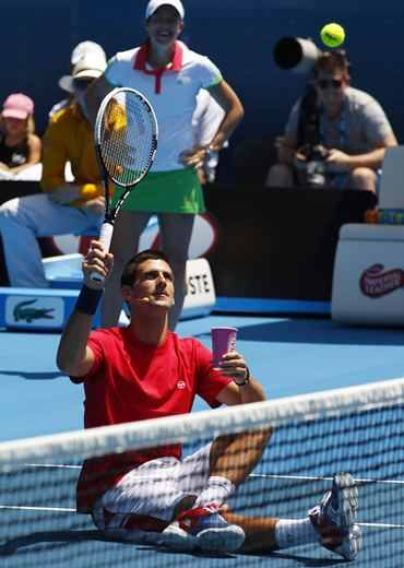 Novak Djokovic entertains the crowd in Melbourne