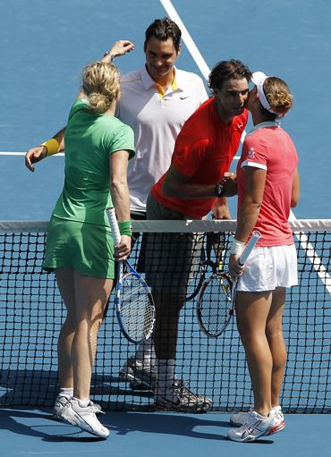 Rafael Nadal (2nd R), Roger Federer,  Sam Stosur (R) and Kim Clijsters (L) embrace at the Rally for Relief tennis match in Melbourne