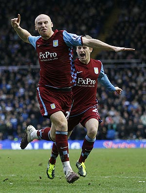 Aston Villa's James Collins (left) celebrates his goal against Birmingham City with Barry Bannan on Sunday