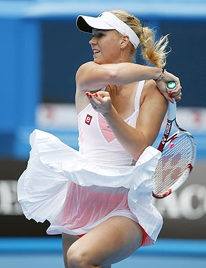 Caroline Wozniacki plays a shot against Gisela Dulko