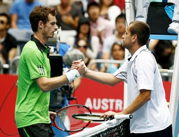 Andy Murray and Karol Beck shake hands after their match