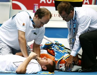 Beck receives medical treatment during his match against Murray