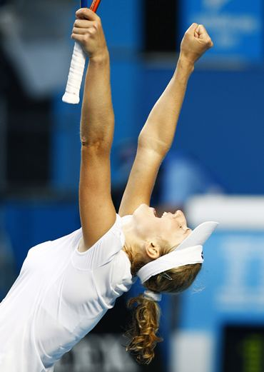Ekaterina Makarova celebrates after beating Ivanovic