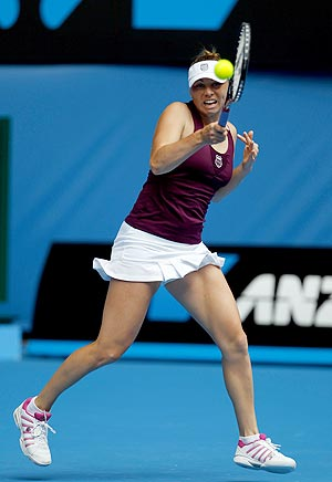 Vera Zvonareva of Russia hits a return against Sybille Bammer of Austria