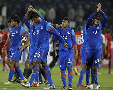 Indian players react after losing a match during the AFC Asian Cup in Doha