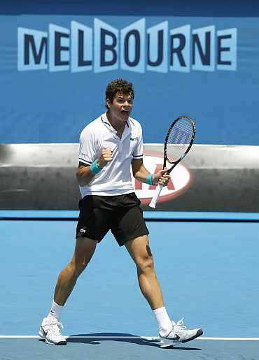 Milos Raonic celebrates after winning his match against Michael Llodra at the Australian Open