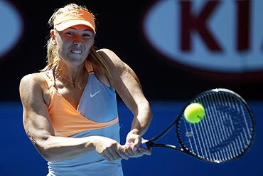 Maria Sharapova hits a return against German Julia Goerges