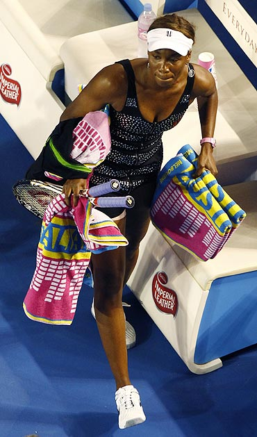 Venus Williams leave the court after retiring from her match against Germany's Andrea Petkovic