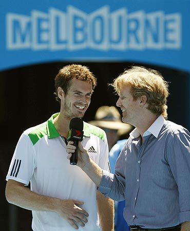Andy Murray of Britain smiles as he is interviewed by Jim Courier on Saturday