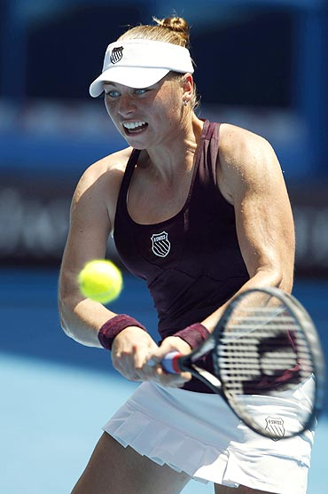 Vera Zvonareva of Russia hits a return to Lucie Safarova of the Czech Republic