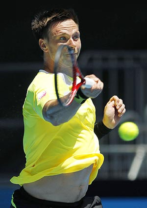 Robin Soderling of Sweden in action against Jan Hernych of the Czech Republic on Saturday