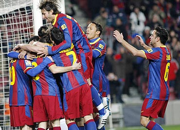 Barcelona's players celebrate Pedro's goal against Racing Santander