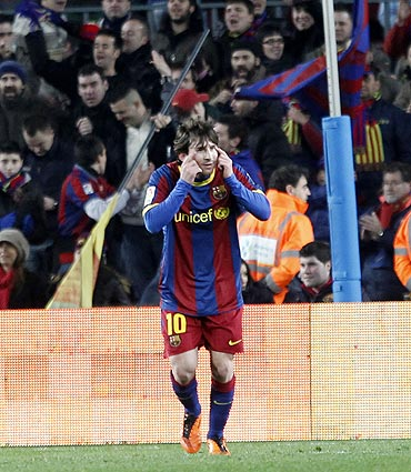 Barcelona's Lionel Messi celebrates his goal against Racing Santander