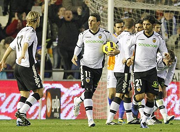 Valencia's Roberto Soldado (2nd from left) celebrates with teammates after scoring against Malaga