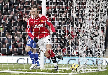 Dimitar Berbatov celebrates after scoring against Birmingham City on Saturday