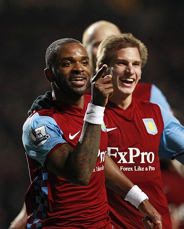 Aston Villa's Darren Bent (centre) celebrates with Marc Albrighton (left) and Stewart Downing after netting against Manchester City on Saturday