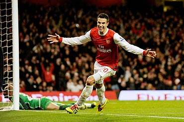 Arsenal's Robin Van Persie celebrates after his third goal against Wigan Athletic