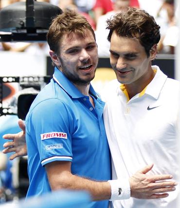 Stanislas Wawrinka congratulates compatriot Roger Federer