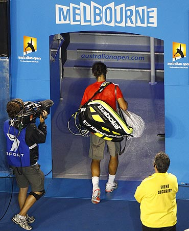 Rafael Nadal leaves the court after losing his quarter-final match against compatriot David Ferrer on Wednesday