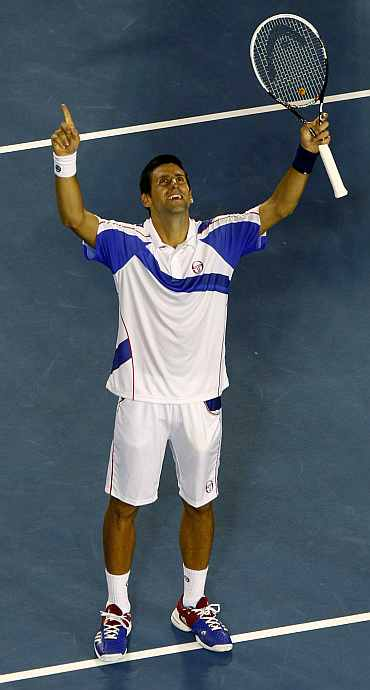 Novak Djokovic celebrates after winning the match against Roger Federer on Thursday