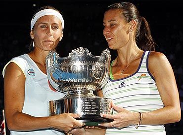 Gisela Dulko and Flavia Pennetta with the doubles trophy