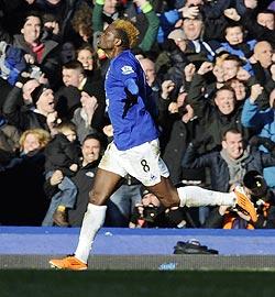 Everton's Louis Saha celebrates scoring against Chelsea on Saturday