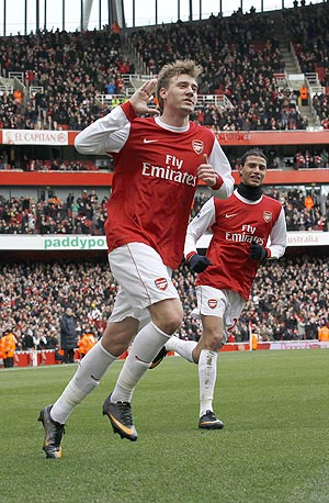 Arsenal's Nicklas Bendtner (left) celebrates his goal against Huddersfield on Sunday