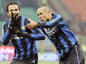 Inter Milan's Giampaolo Pazzini (left) celebrates with teammate Houssine Kharja after scoring against Palermo on Sunday