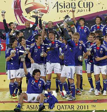 Japan players celebrate after winning the AFC Asian Cup