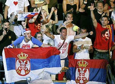 Serbia supporters celebrate in the stands after Novak Djokovic defeated Andy Murray on Sunday