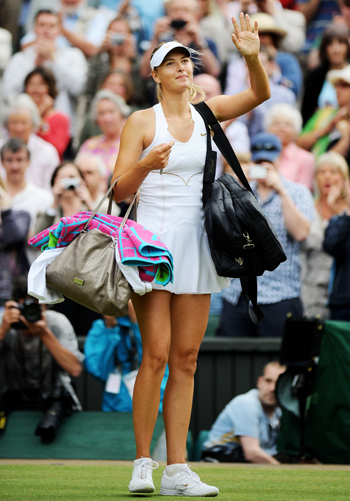 Maria Sharapova of Russia waves to the crowd after winning her semifinal round match against Sabine Lisicki of Germany at the Wimbledon in London