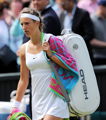 Victoria Azarenka of Belarus walks off the court after losing her Women's semifinal match against Petra Kvitova of the Czech Republic on Day Ten of the Wimbledon Lawn Tennis Championships