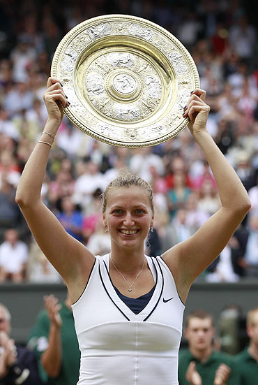 Petra Kvitova of the Czech Republic with the winners' trophy