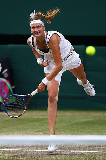 Petra Kvitova serves to Maria Sharapova